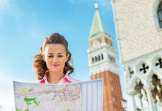Woman looking at map in venice, italy Stock Image