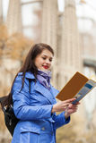 Woman looking at the map Royalty Free Stock Images