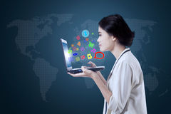 Woman looking at media app icons Stock Image