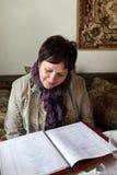 Woman looking at menu Royalty Free Stock Images