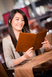 Woman looking at the menu Royalty Free Stock Photography