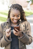 Woman looking message on cellphone with surprised and emotion  Royalty Free Stock Photo