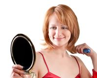 Woman looking into a mirror Stock Images