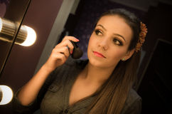 Woman looking in mirror. Attractive young woman looking at reflection in mirror Stock Images