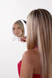 Woman looking at the mirror Royalty Free Stock Photos
