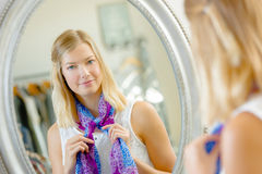 Woman looking at mirror Stock Photo
