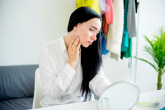 Woman looking in the mirror Royalty Free Stock Photos