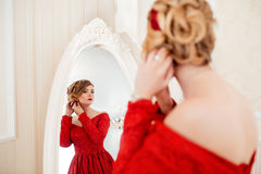 Woman looking in mirror Stock Photography