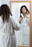 Woman looking in the mirror Royalty Free Stock Image
