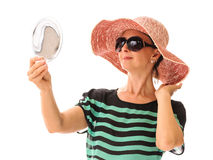 Woman looking in mirror summer accessories Stock Photo