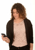 Woman looking at mobile phone Stock Images