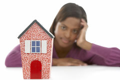 Woman Looking At Model House Royalty Free Stock Photo