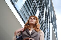 Woman Looking at Modern Office Building Royalty Free Stock Image