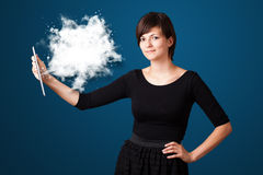 Woman looking at modern tablet with abstract cloud Royalty Free Stock Photography