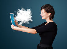 Woman looking at modern tablet with abstract cloud Royalty Free Stock Photo