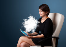 Woman looking at modern tablet withabstract cloud Stock Photography