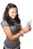 Woman looking at money. Young woman staring at money isolated on white background Royalty Free Stock Images