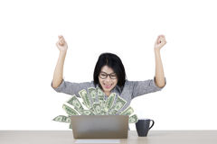 Woman looking at money on laptop Royalty Free Stock Photo