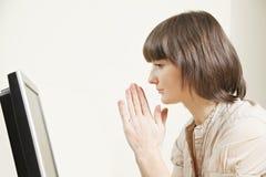 Woman looking at monitor Royalty Free Stock Image