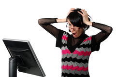 Woman looking at the monitor getting a surprise Stock Image