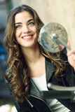Woman looking in a motorbike's mirror Stock Images