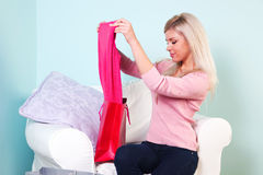 Woman looking at the new clothes she just bought Stock Image