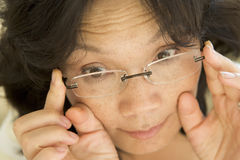 Woman Looking Through New Glasses Royalty Free Stock Photos