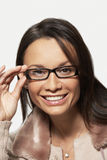 Woman Looking Through New Glasses Royalty Free Stock Photo
