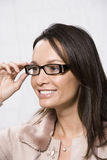 Woman Looking Through New Glasses Stock Images