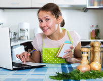 Woman looking for new recipe Royalty Free Stock Images