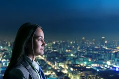 Woman looking at night city Stock Photos