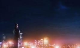 Woman looking at night city Stock Image