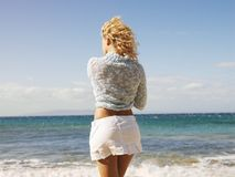 Woman looking at ocean Royalty Free Stock Images