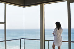 Woman Looking At Ocean View From Balcony Stock Photos