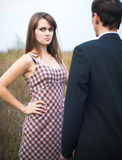 Woman looking offended over man shoulder Royalty Free Stock Image