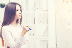 Woman looking at an office whiteboard Royalty Free Stock Photo
