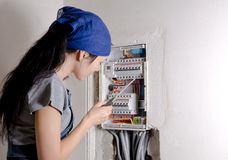 Woman looking at an open electrical Stock Photo