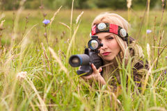 Woman looking into the optical sight. Laser tag Stock Images