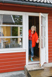 Woman looking out of a cabin door Royalty Free Stock Image