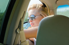 Woman looking out of a car window Royalty Free Stock Photos