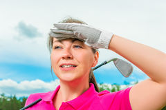 Woman looking out for flying ball Stock Photo