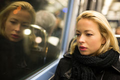Woman looking out metro's window. Royalty Free Stock Photos