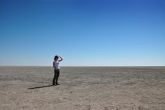 Woman looking out over Etosha pan Stock Photo