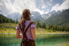 Woman looking out over a lake Royalty Free Stock Photography