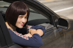 Woman looking out of passanger window of car smiling Stock Image