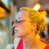 Woman looking out tram's window. Royalty Free Stock Image