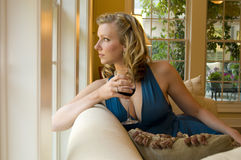 Woman looking out of the window Royalty Free Stock Photos