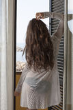 Woman looking out window Stock Images