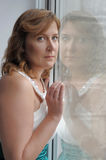 Woman looking out of window Royalty Free Stock Photo