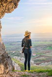 Woman looking outside of the cave Stock Image